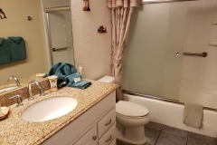 Upgraded Bathroom with new vanity and granite counter top.