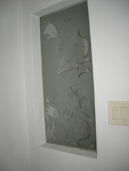 Hall / guest bathroom includes a Custom etched window with tropical scene