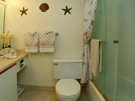 Upgraded master bathroom, tiled vanity top, new tiled shower over tub, flooring and glass door enclosure