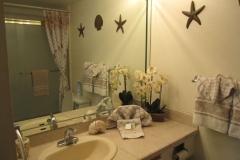 Upgraded master bathroom, tiled vanity top, new tiled shower over tub, floor tile and glass door enclosure